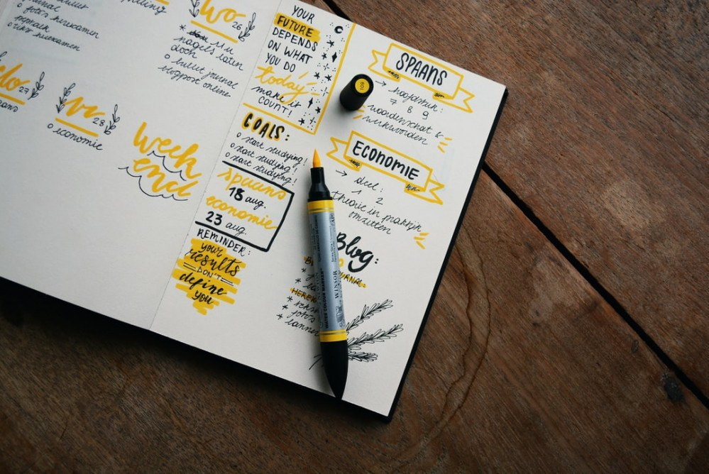 Planner and pen on a table