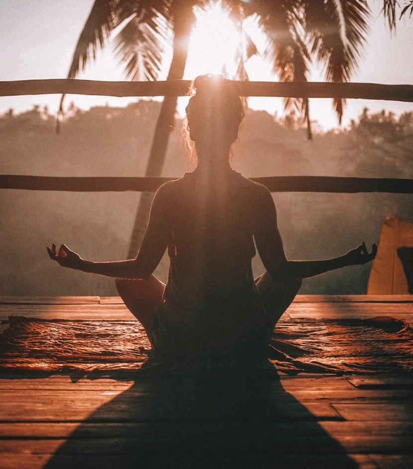 woman in sunlight meditating